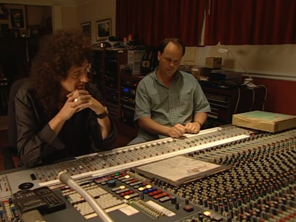 Brian May at a mixing desk reviewing Bohemian Rhapsody